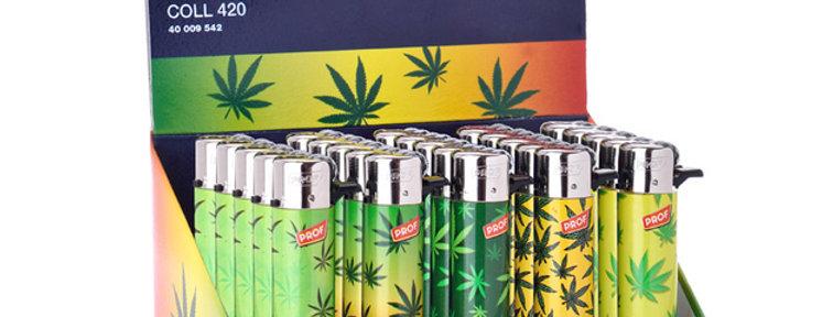 Grinding lighter cannabis leaf