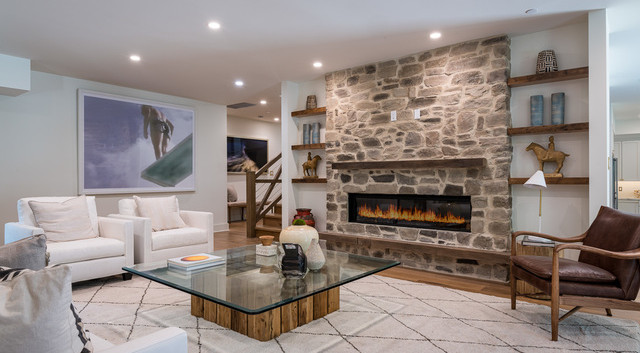 Den with stone fire place