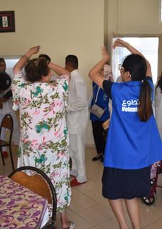 Qalam volunteers with the elderly