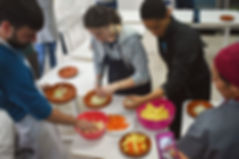 Students learning to cook Moroccan food