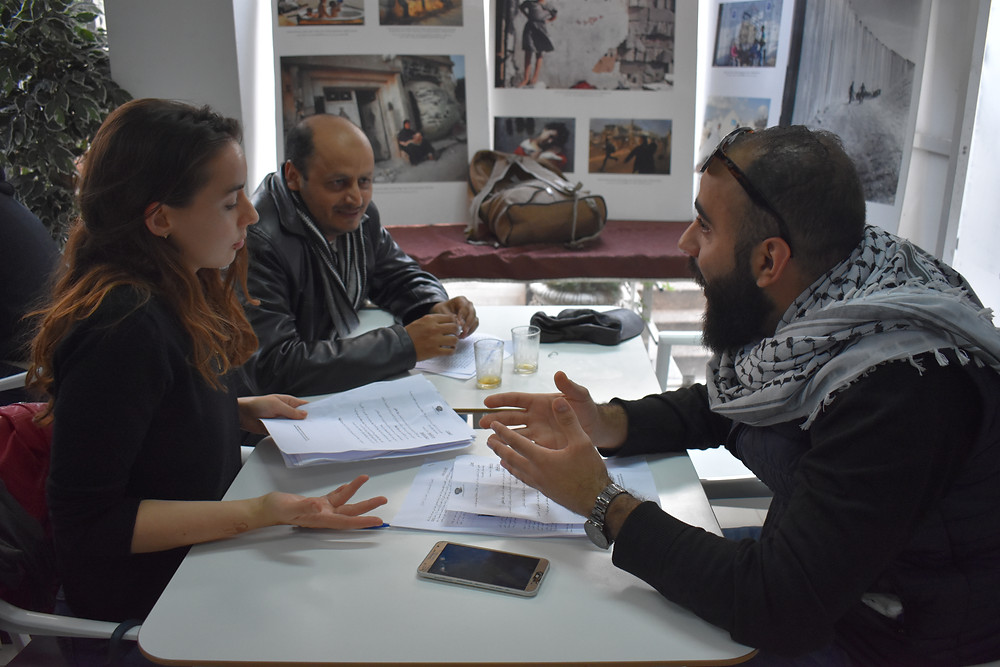 Arabic students use communication to engage in a discussion about Palestine