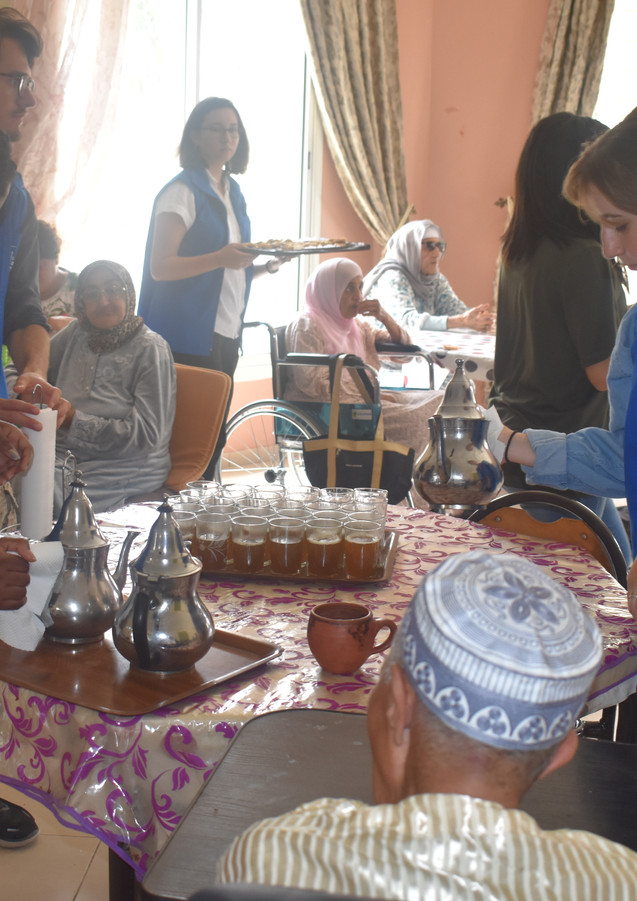 Qalam volunteers with the elderly