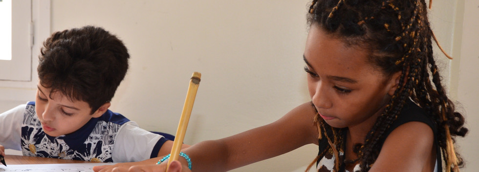 Young students learn Arabic calligraphy