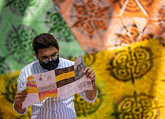 A visitor looks at a map outisde the Mexico Pavilion_Web Image_m3751.jpg