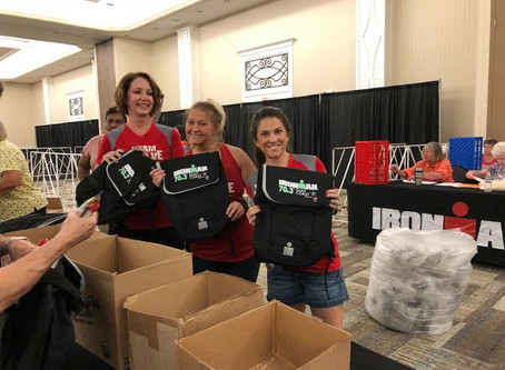 Team Evolve ladies giving back to the community by volunteering for the IronMan 70.3 Gulf Coast!