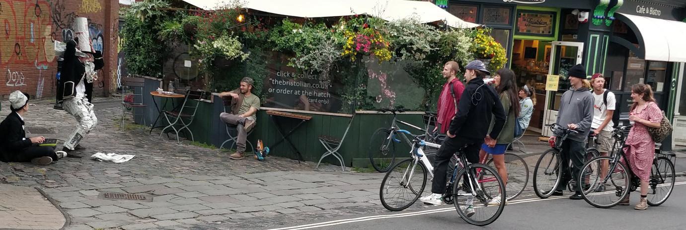 Newspaper Man with audience on bikes.jpg