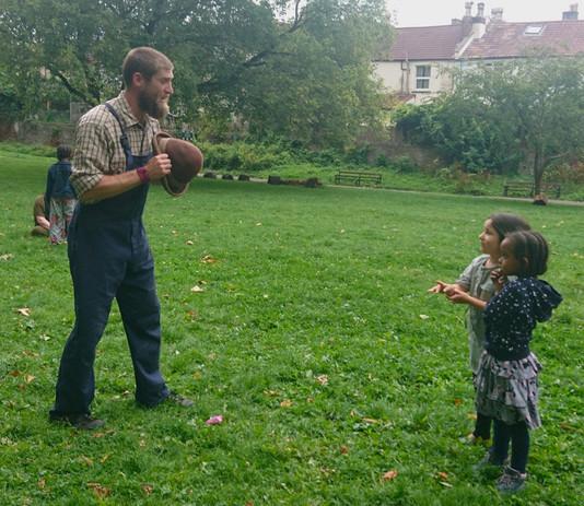 Farmyard Circus do hat tricks with kids.jpg
