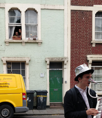 Newspaper Man with a window audience.jpg