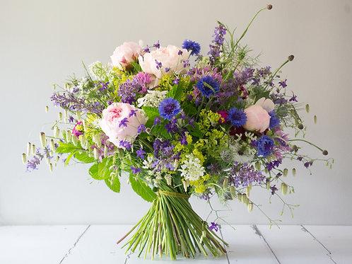 Hand-tied fresh flower bouquet in seasonal colours