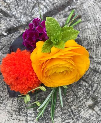 Poppy, ranunculus and pom-pom buttonhole