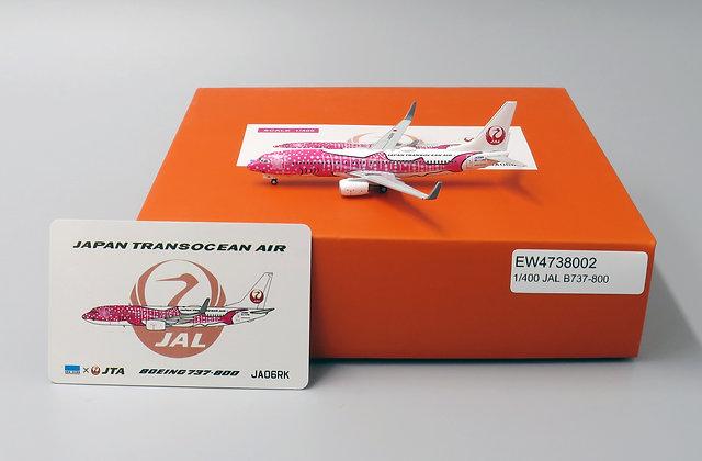 JAL B737-800 Reg: JA06RK With Aircraft tug truck EW Wings 1:400 EW4738002