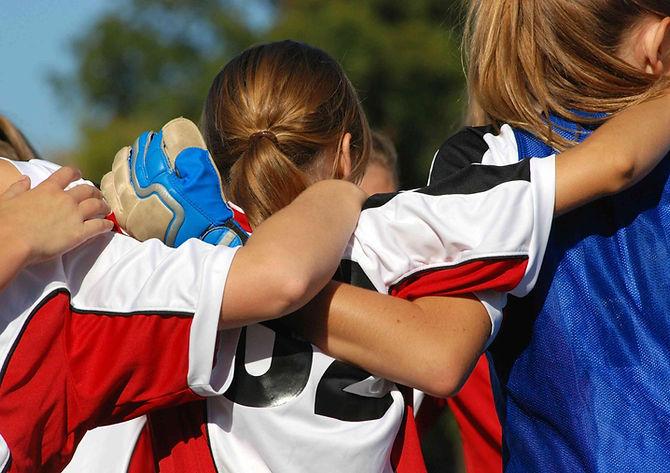 bigstock-Soccer-Team-Huddle-4367975-c-r.