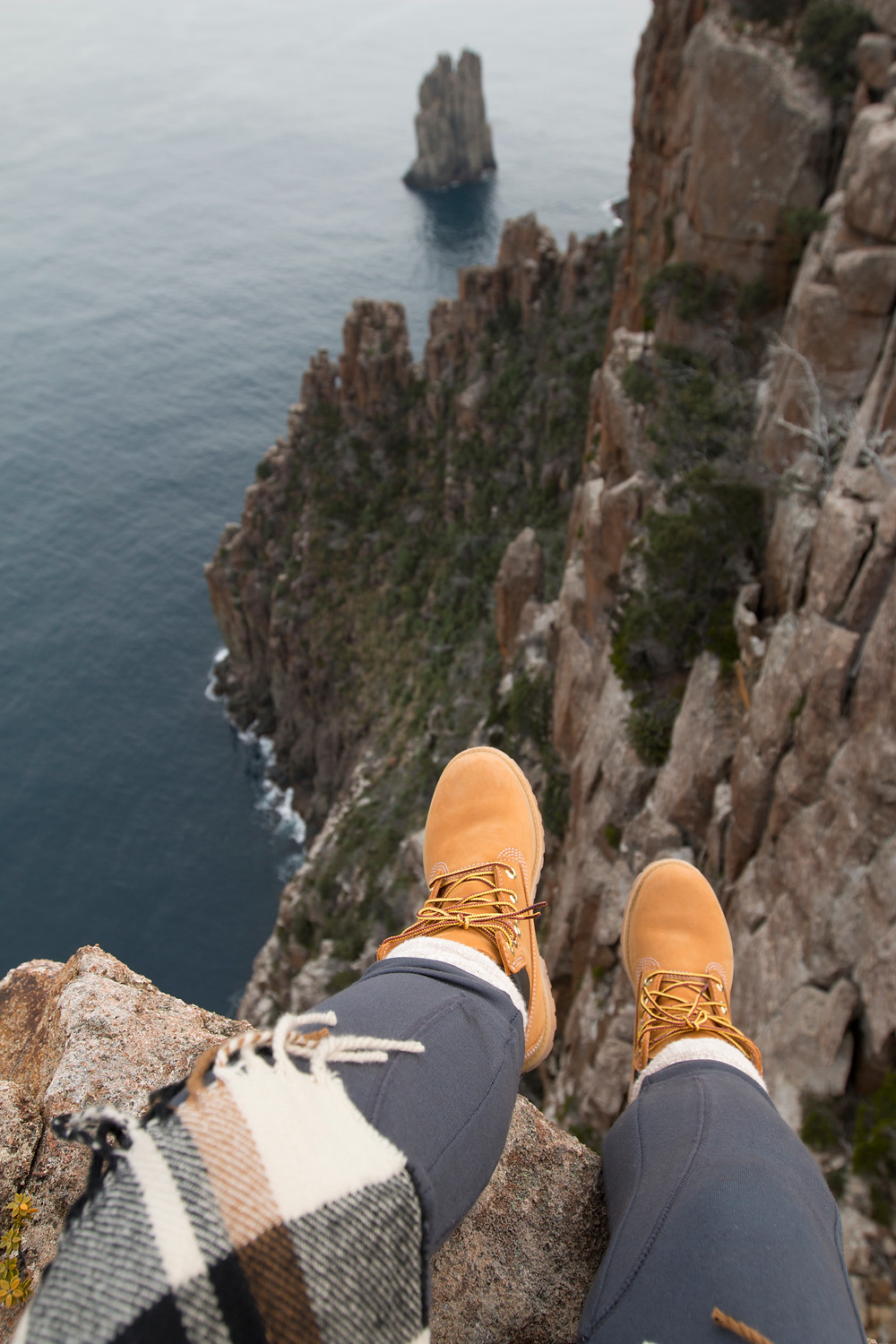 Trusty Timberlands hanging over the edge.