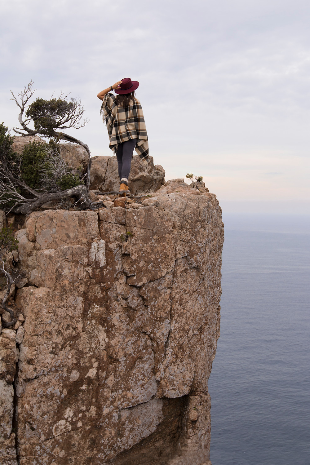 Sturdy boots needed when peaking over cliffs of Cape Hauy.