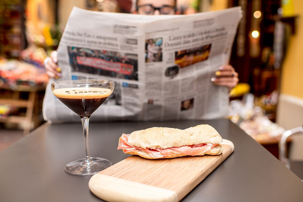 Finding some Italian newspapers is a fun way to decorate for your aperitivo.