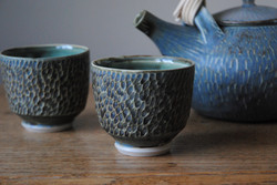 Carved teaset bowl closeup