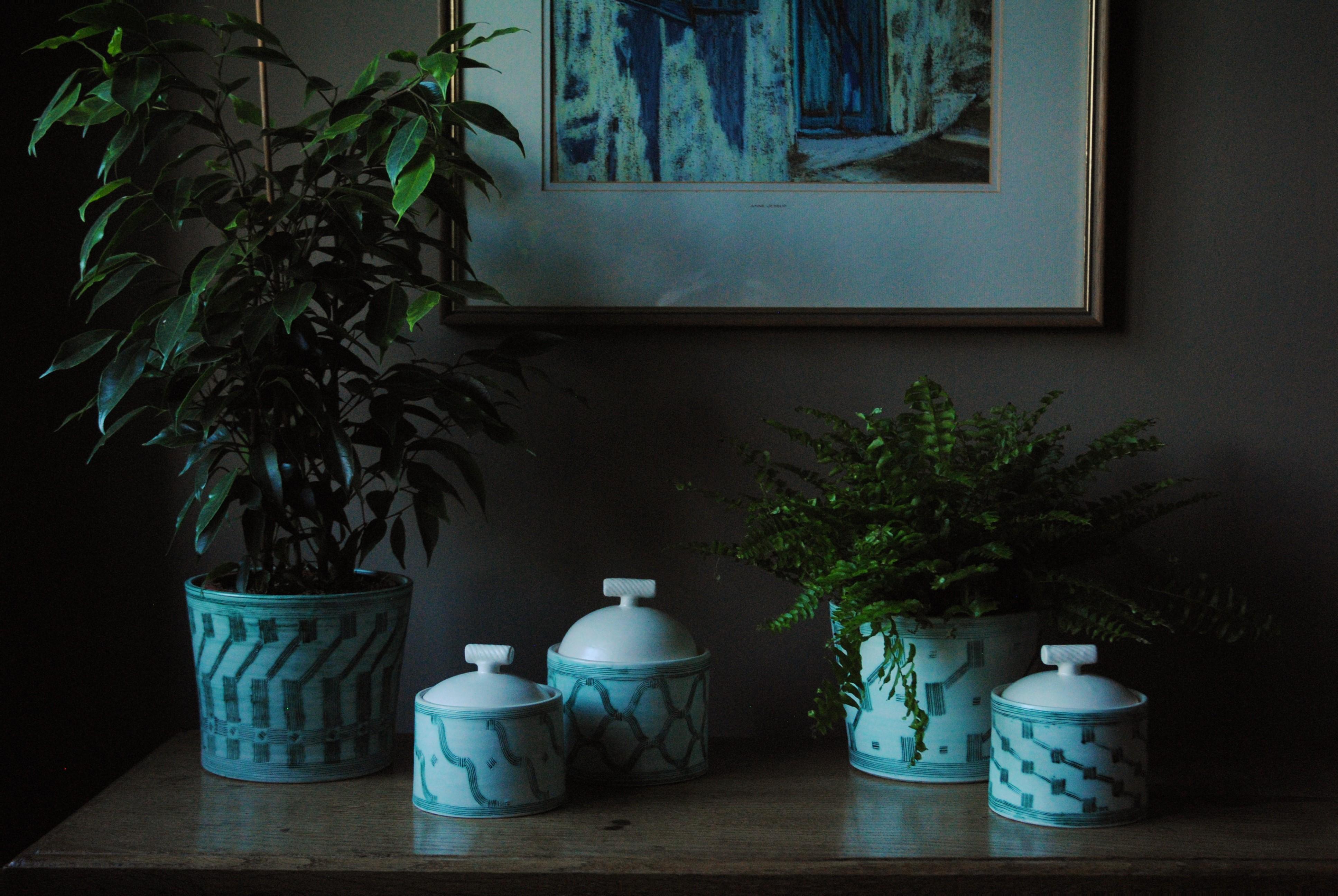Lidded pots and cache pots