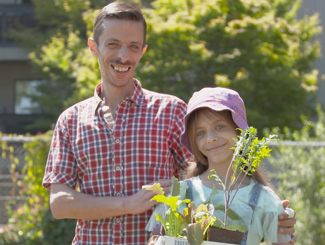 Daughter and Father holding plant seedlings