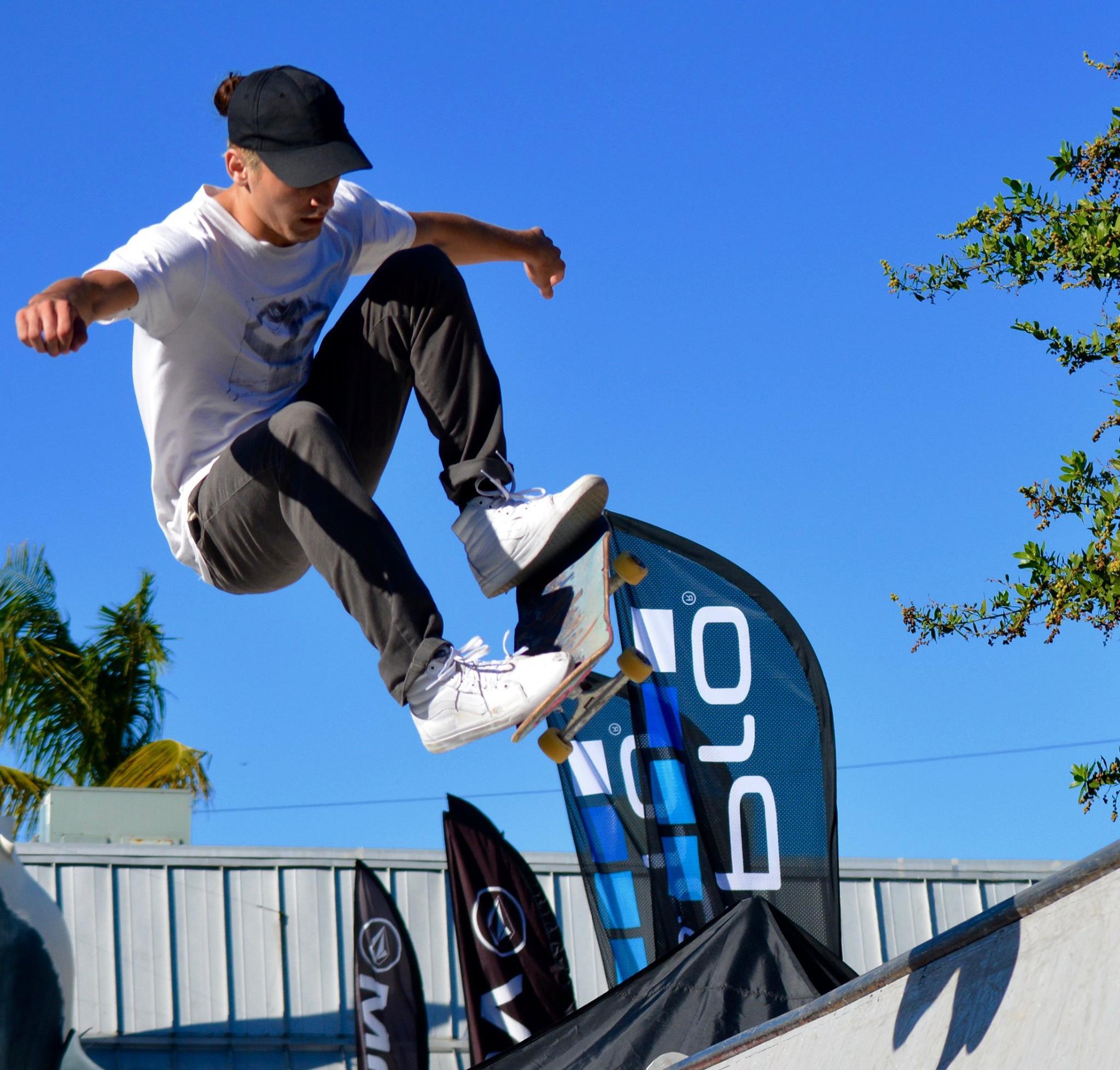 Dude getting air on his skateboard