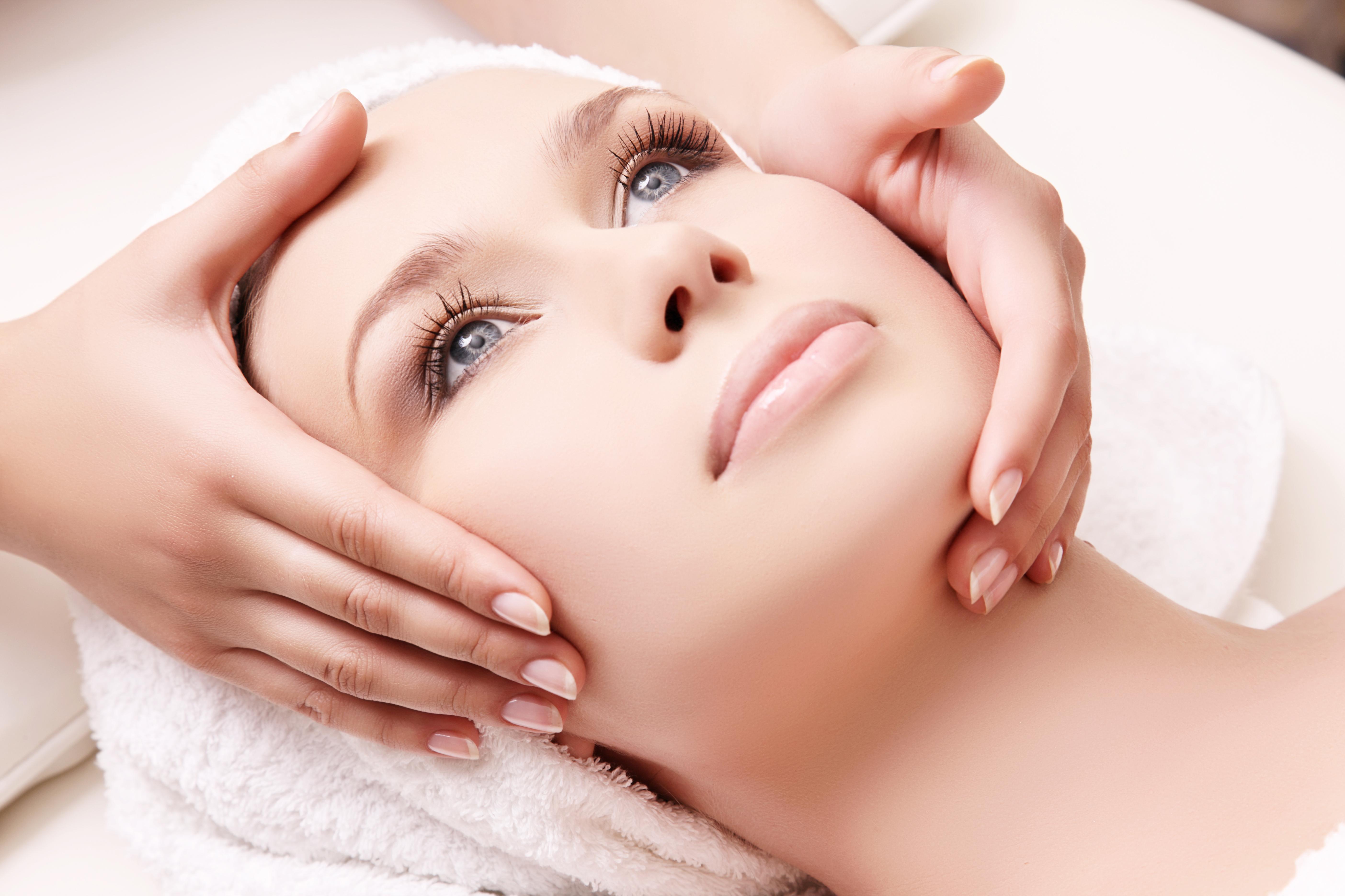 Beautiful woman receiving facial massage