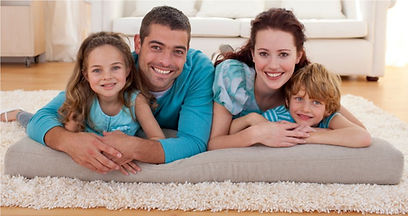 Family laying on clean carpet