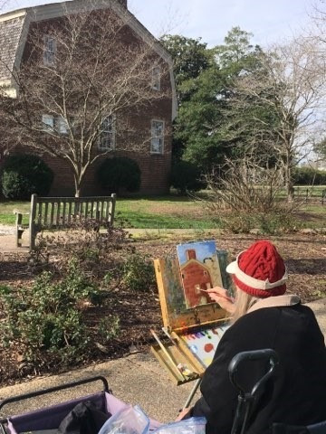 Photo of a Plein Air painter at the Francis Land House from earlier this year.