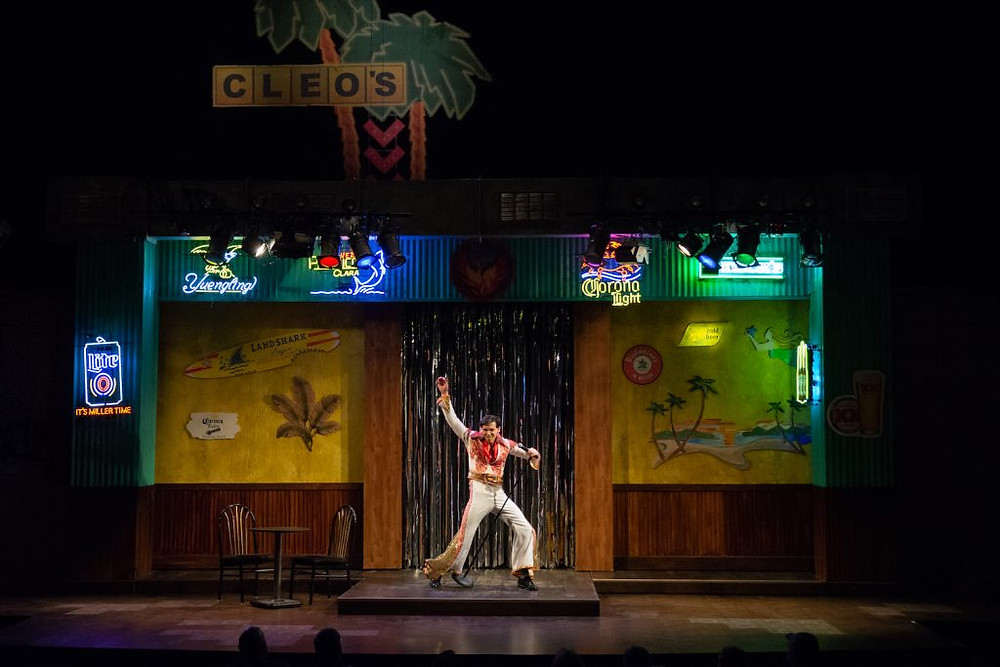 An image from The Legend of Georgia McBride at VSC. An Elvis impersonator performing on stage.