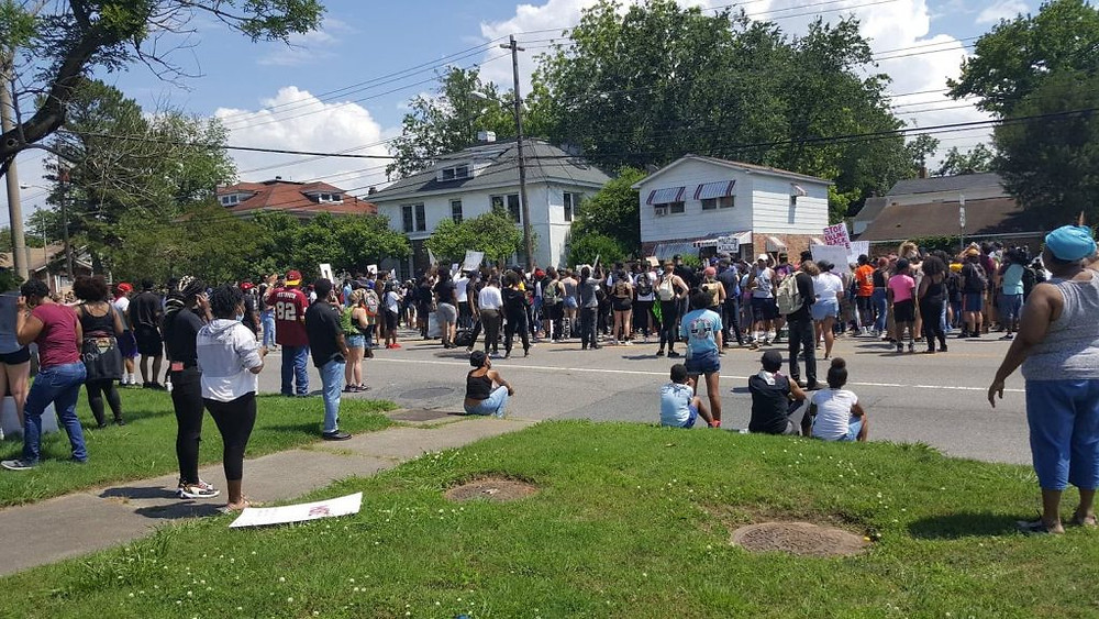 A large gathering at a protest on a street in Hampton Roads