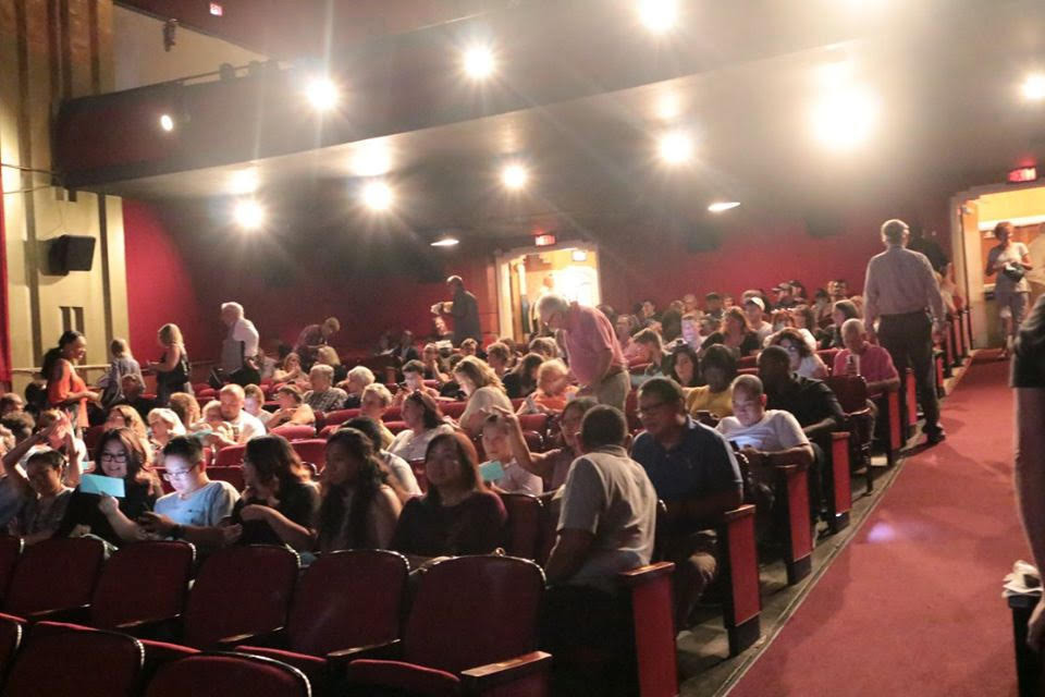 The inside of the Naro Theater as the crowd is seated for a viewing