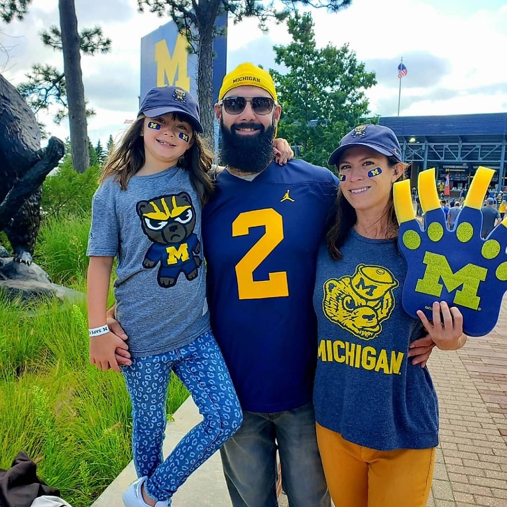 Hailey Neef and family in Michegan gear outside a game