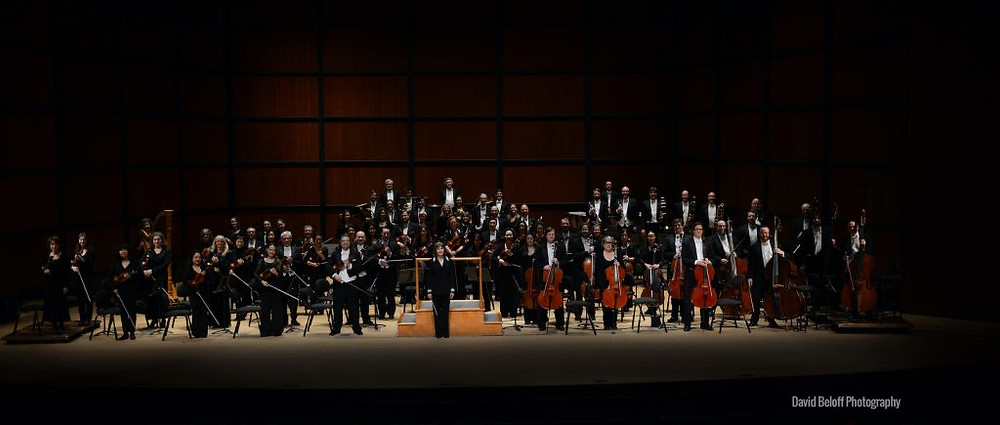 Virginia Sypmhony Orchestra stands on stage before they take a bow
