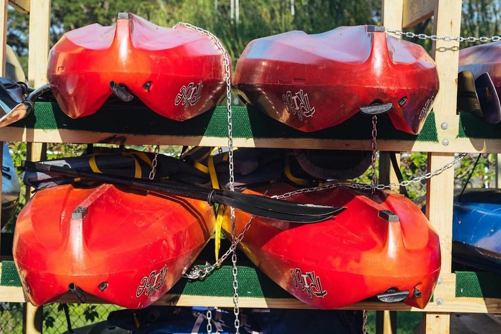 4 red kayaks in storage