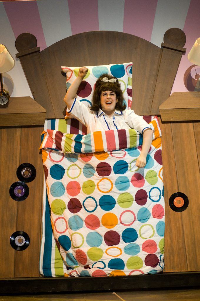 Tracy Turnblad in her bed during their performance of Hairspray