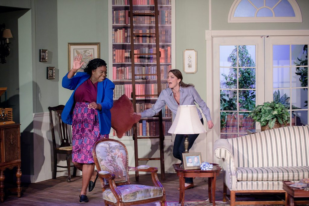 A scene from LTVB's An American Daughter. Two actors chase each other around the stage with a pillow.