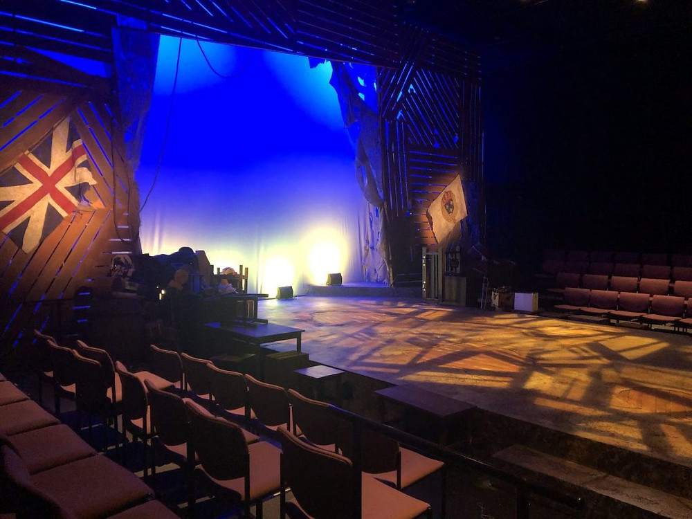 An empty stage and theater, taken during the last show that BA worked on as a lighting designer before the pandemic, A Tale of Two Cities at Regent University. Luckily, they were able to complete their run.