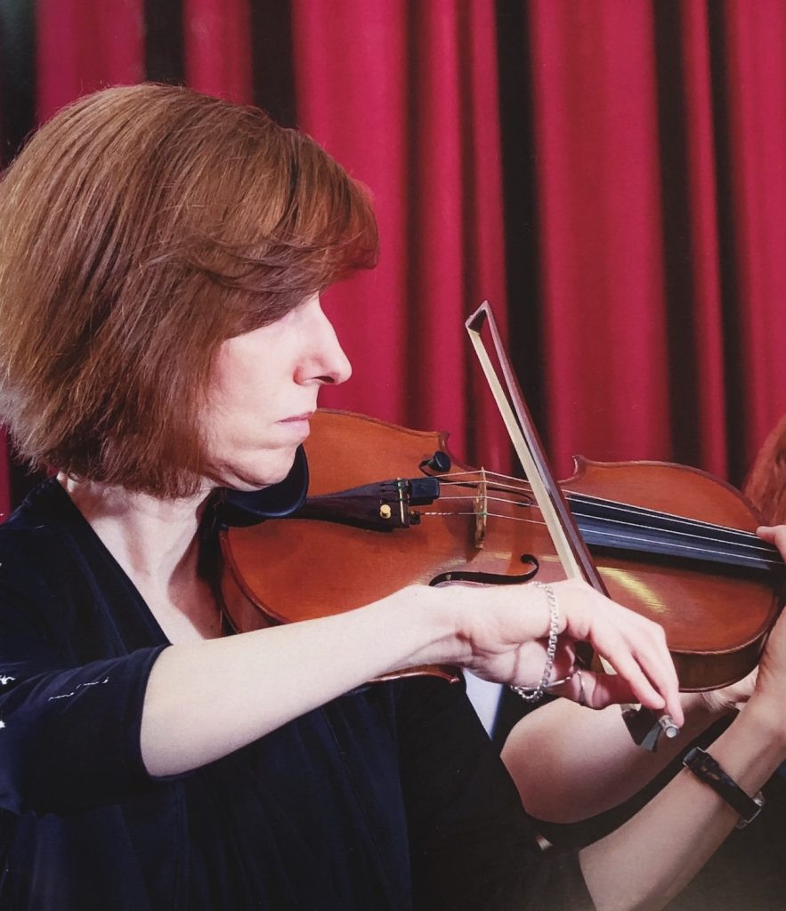 Peggy Watson playing the violin in profile