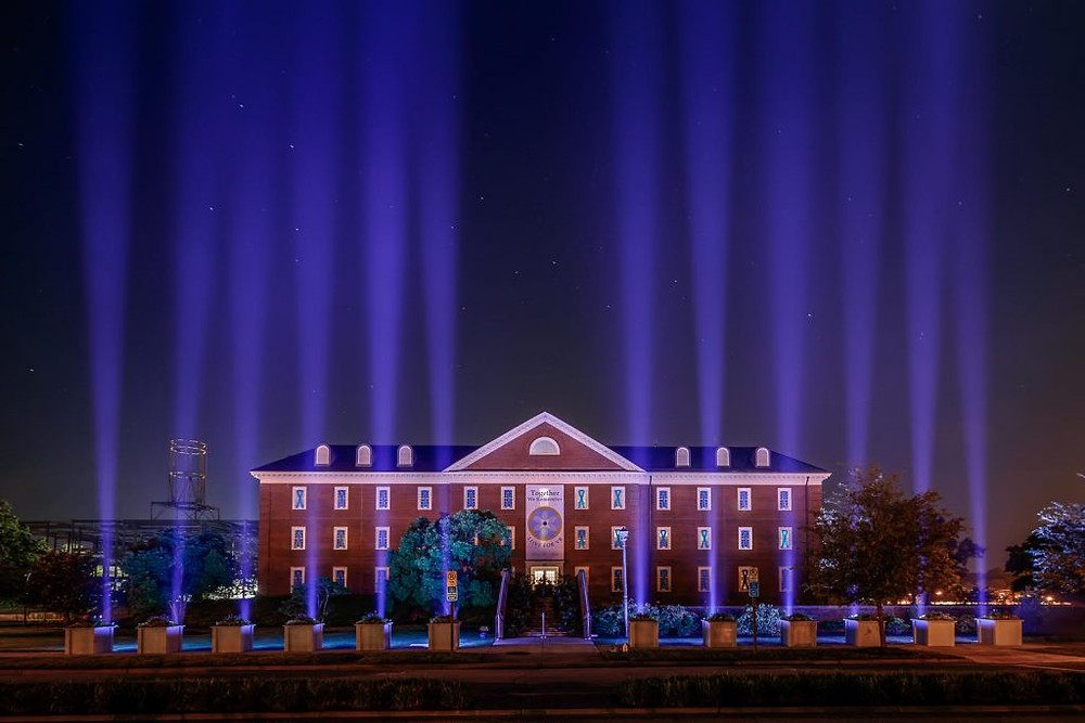 VB government building with blue lights for the memorial.