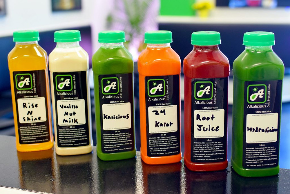 A rainbow variety of juice bottles