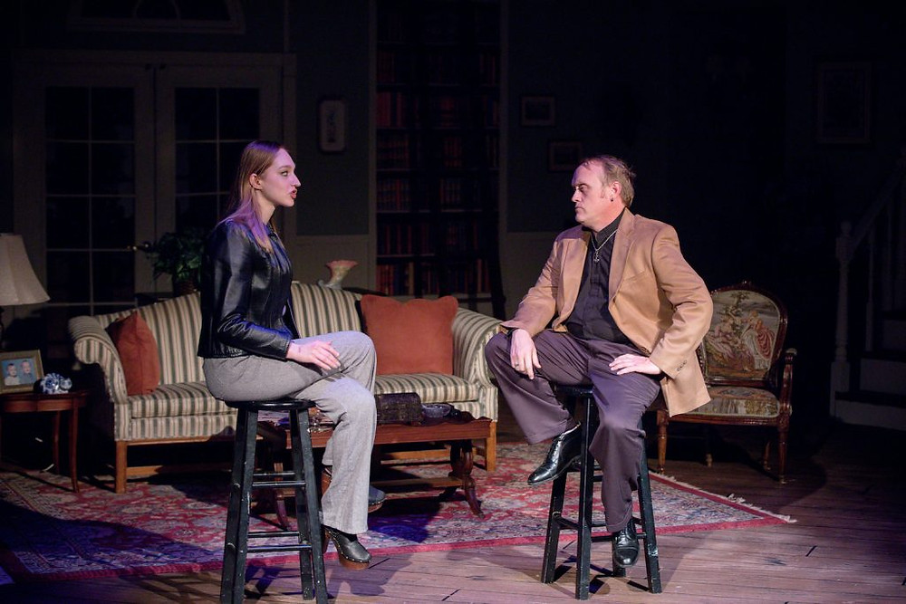 A scene from LTVB's An American Daughter. Two actors are sitting on stools talking like in an interview.