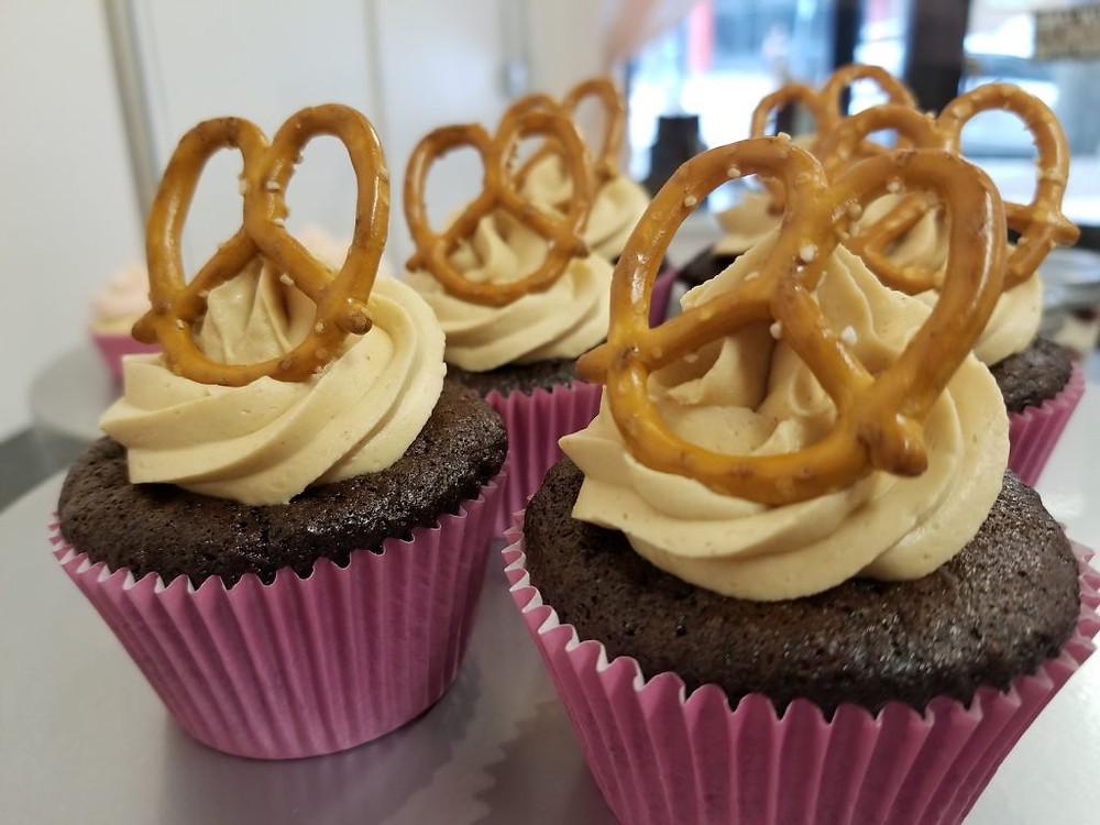 chocolate cupcakes with icing and pretzels