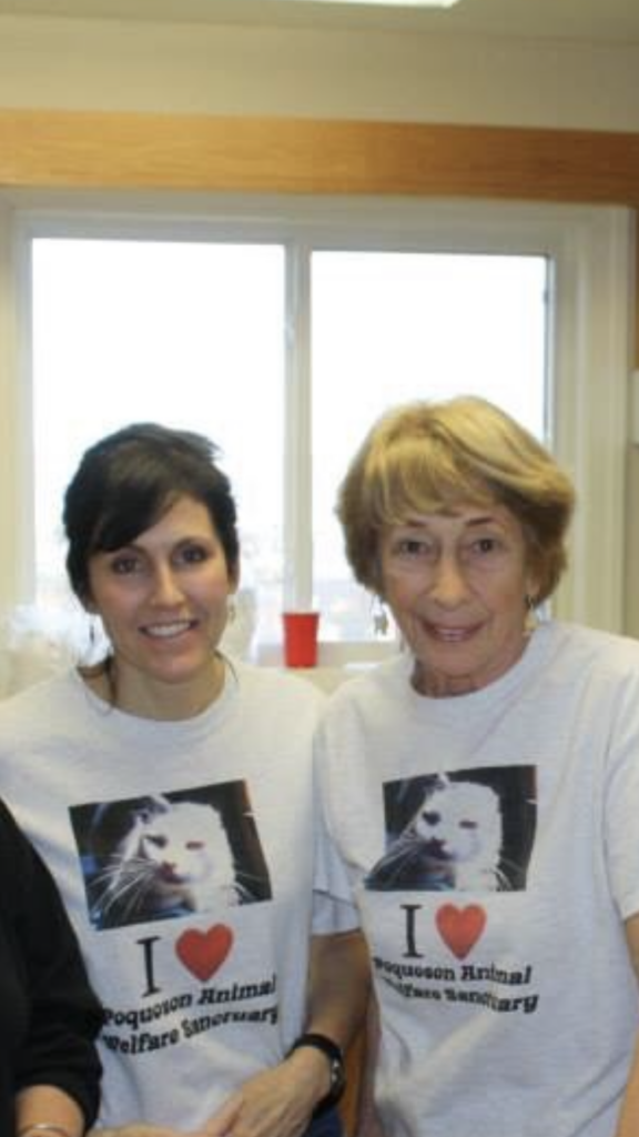 "Two women wearing shirts that say ""I heart Poquoson Animal Wellness Sanctuary"""