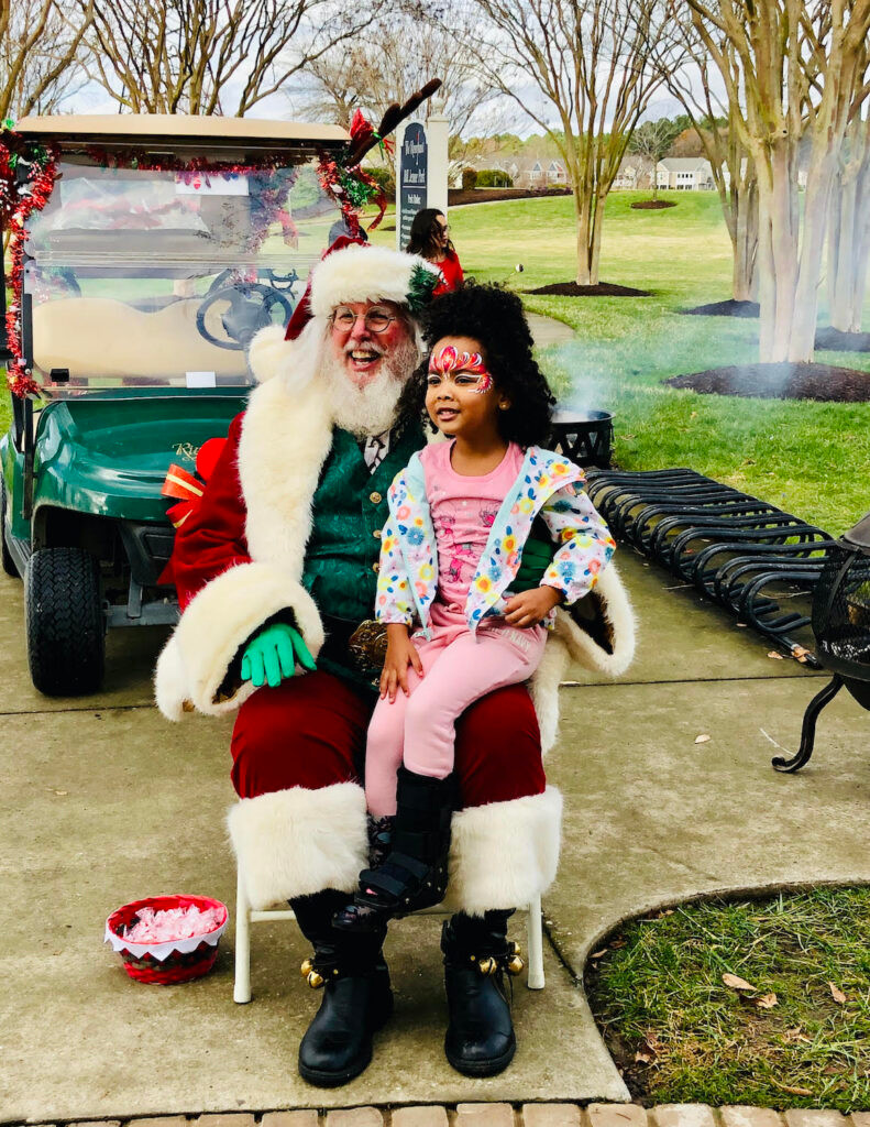 A child sits on Santa's lap at least year's holiday celebration