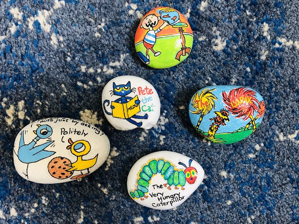 Penny's painted rocks with a variety of children's book characters.