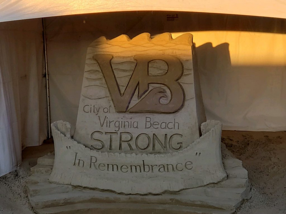 "A sandcastle that reads ""City of Virginia Beach Strong. In Remembrance."