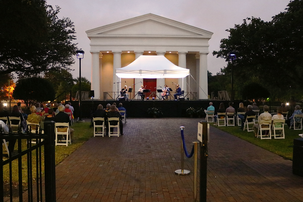A view of the stage for the Fall Music Celebration, You can see the audience seated in a socially distant manner in the mid-ground.