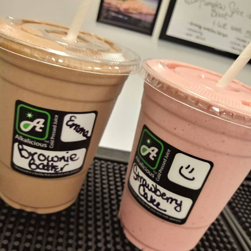 Two different smoothies, one is brownie batter and one is Strawberry