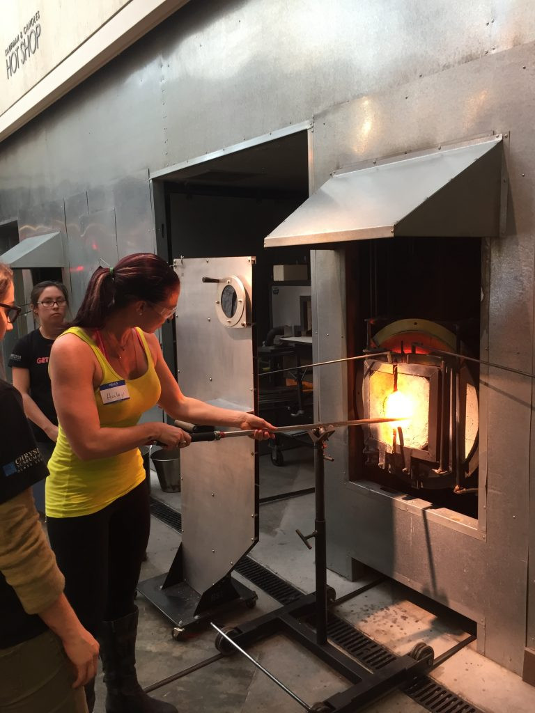 Dr Haley Neef blowing glass at the Chrylser Glass Studio