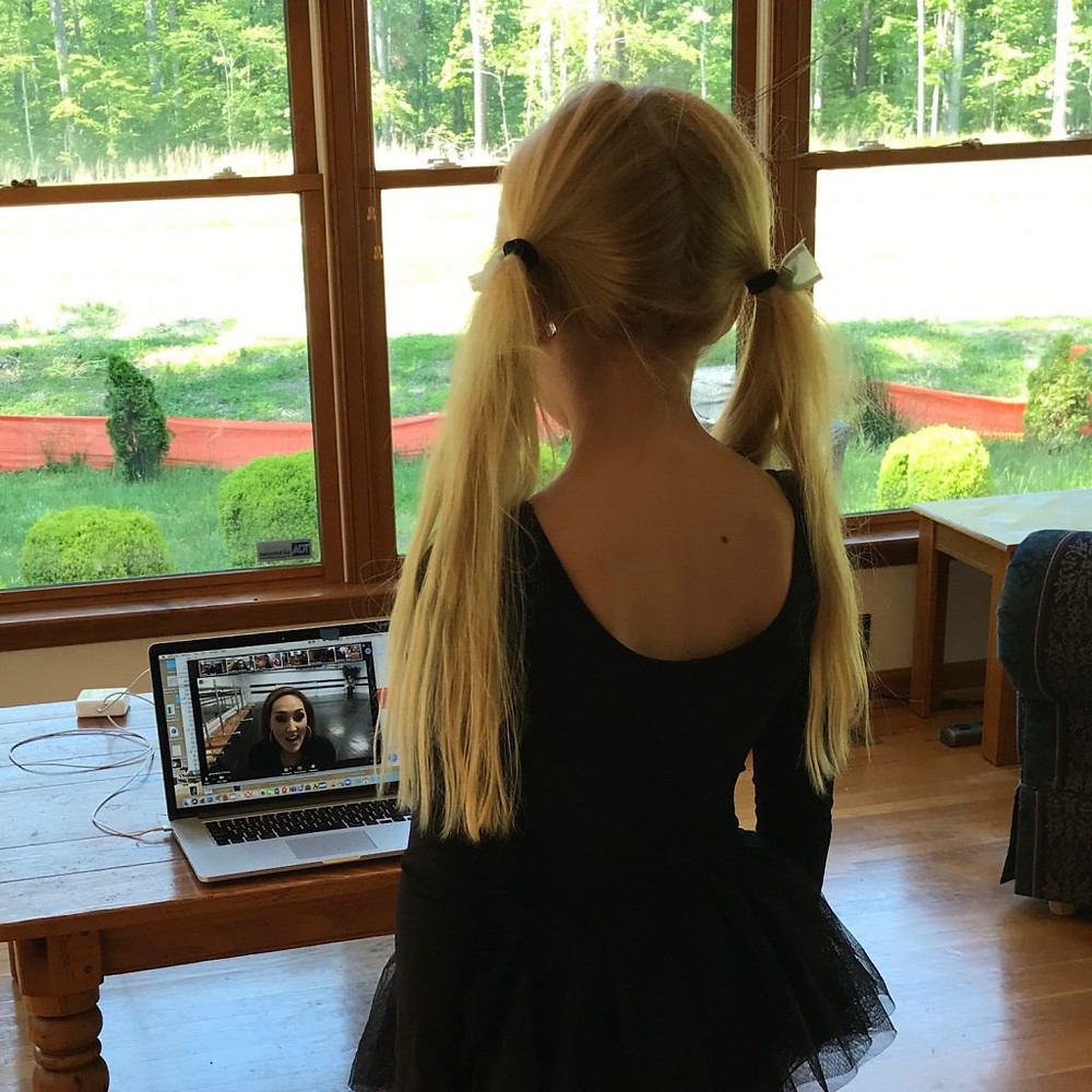 A dance student takes an Academy class on zoom.