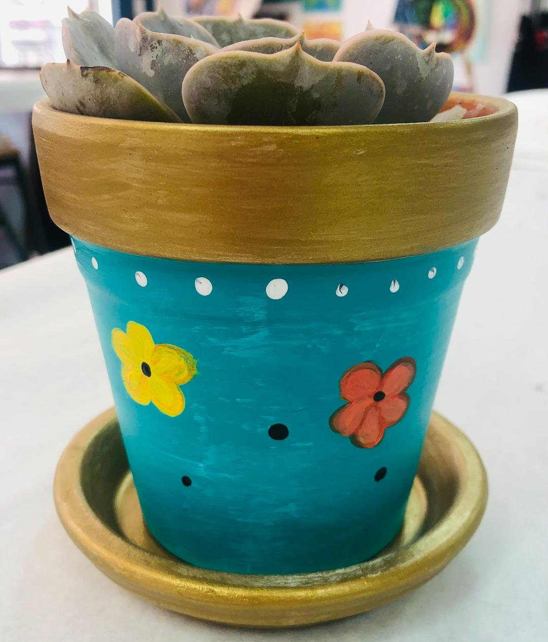 Clay painting pot with succulent