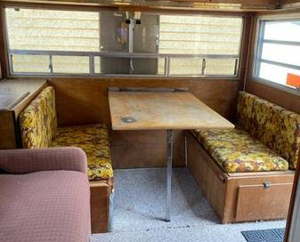 Dinette folds down into a bed.  Large bunk bed above